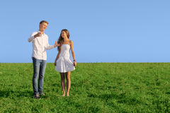 Young couple on summer field Stock Image