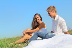 Young couple on summer field Stock Photos