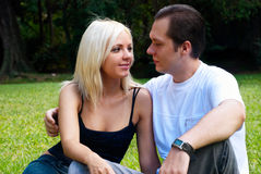 Young couple in a summer garden Royalty Free Stock Images