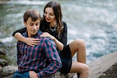 Young couple in the summer on the nature near the river. Love story royalty free stock photos