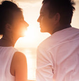 Young couple at sun background Stock Photo