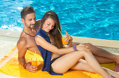 Young couple sunbathing and drinking cocktails. Stock Photography