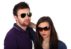 Young couple with sunglasses. Young couple wearing sunglasses on white Royalty Free Stock Photos