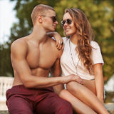 Young couple with sunglasses outdoors Stock Photos