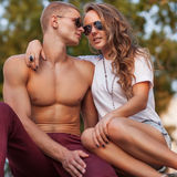 Young couple with sunglasses outdoors Stock Photo