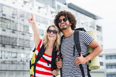 Young couple in sunglasses standing on terrace Royalty Free Stock Photos