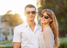 Young couple. In sunglasses at sunset Royalty Free Stock Photos