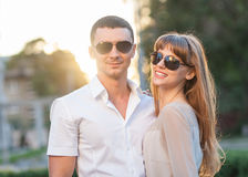 Young couple. In sunglasses at sunset Stock Image