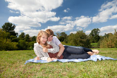 Young couple in sunny day. Happy young couple in sunny day on the meadow Royalty Free Stock Photos