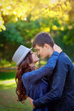 Young couple in sunset embraced together Royalty Free Stock Photo
