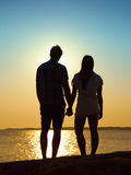 Young couple and sunset Royalty Free Stock Images