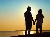 Young couple and sunset Royalty Free Stock Photo