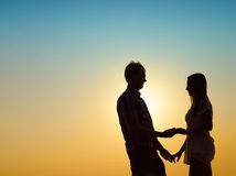 Young couple and sunset Stock Image