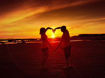 Young couple at sunset. Royalty Free Stock Photos