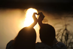 Young couple on a sunset. Royalty Free Stock Images