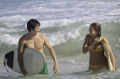 Young couple surfing in hawaii Royalty Free Stock Images