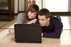 Young couple surfing the net Stock Photography