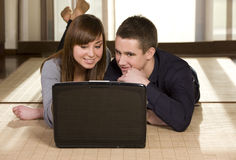 Young couple surfing the net Stock Image
