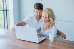 Young couple surfing the web on a laptop Stock Images
