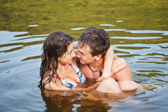 Young couple swimming royalty free stock image
