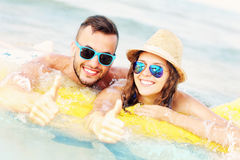 Young couple swimming on a matress Royalty Free Stock Photography