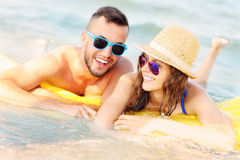 Young couple swimming on a matress Stock Photography