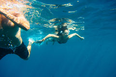 Young Couple Swimming. In the mediterranean sea royalty free stock photos
