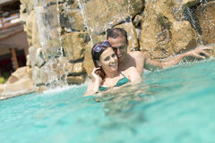 Young couple in the swimming pool Royalty Free Stock Image