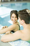 Young couple in the swimming pool Stock Images
