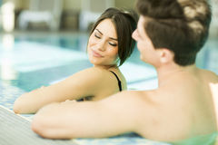 Young couple in the swimming pool Royalty Free Stock Photo
