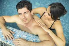 Young couple in the swimming pool Stock Image