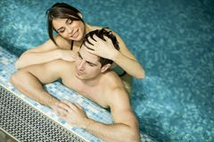 Young couple in the swimming pool Royalty Free Stock Images