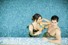 Young couple in the swimming pool. Young couple resting in the swimming pool Stock Photos