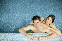 Young couple in the swimming pool. Young couple resting in the swimming pool Stock Image