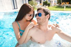 Young couple in swimming pool Stock Photo