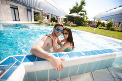 Young couple in swimming pool Stock Image