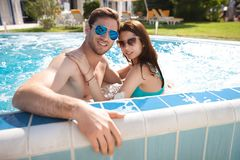 Young couple in swimming pool Royalty Free Stock Image