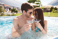 Young couple in swimming pool Royalty Free Stock Images