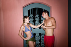 Young couple in swimsuits flirting Stock Image