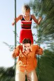 Young couple on swing Royalty Free Stock Photography