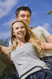 Young couple on a swing Stock Photography