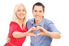 Young couple symbolizing love with hands Stock Photos