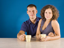 Young couple at the table Royalty Free Stock Photo