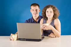 Young couple at the table with laptop stock photo