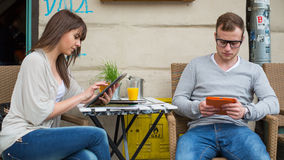 Young couple with tablet in café. Royalty Free Stock Photography