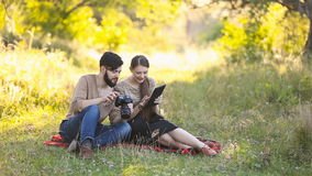 Young couple with a tablet and camera stock video footage