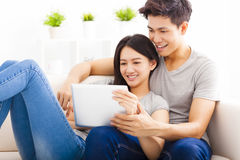 Young Couple  with tablet computer Royalty Free Stock Images
