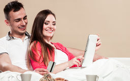 Young couple with tablet and credit card at home Royalty Free Stock Photography