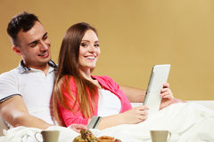 Young couple with tablet and credit card at home Royalty Free Stock Images