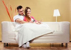 Young couple with tablet and credit card at home Royalty Free Stock Photos